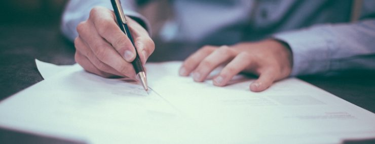 Male signing contract