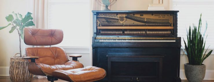 Arm chair and piano in living room