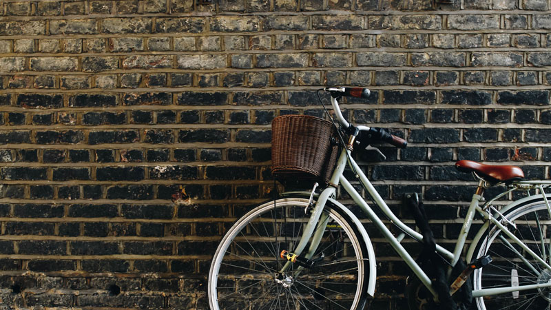 Bike leaning against a brick wall