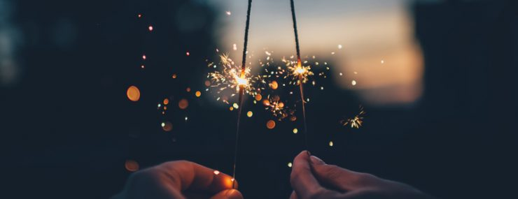 Two hands holding sparklers